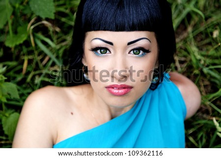 Portrait of attractive lady outdoors in blue dress - stock photo
