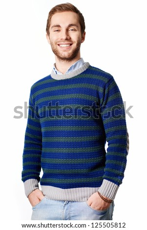 Portrait of attractive male in casual clothes looking at camera with smile - stock photo