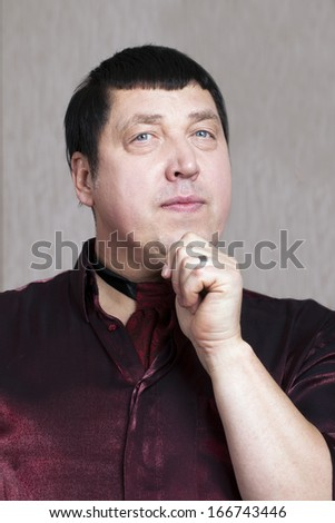 Portrait of attractive man in red shirt.