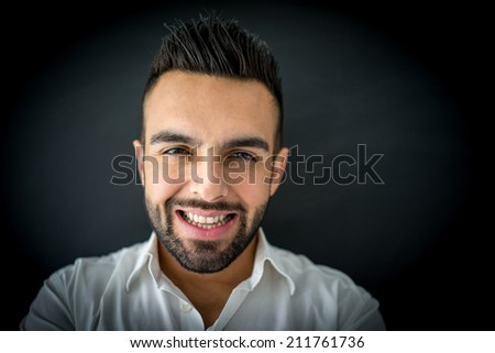 Portrait of attractive man standing