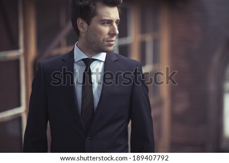 Portrait of attractive man wearing suit