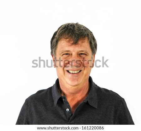 portrait of attractive man with black shirt in studio - stock photo