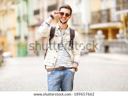 Portrait of attractive man with casual clothes walk in Europe - stock photo