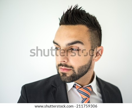 Portrait of attractive man with stylish hair standing