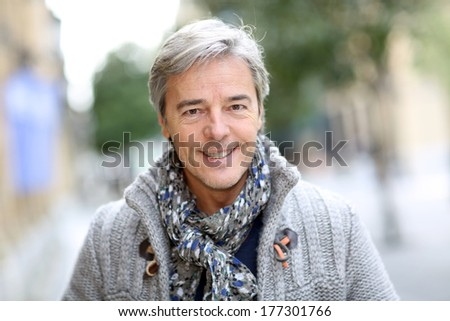 Portrait of attractive mature man in town - stock photo