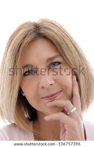 Portrait of attractive mature woman wearing a wedding ring with her hand to her face isolated on white