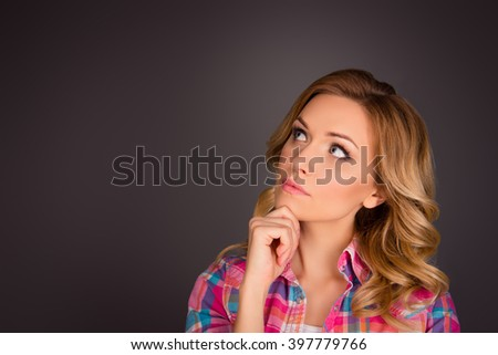 Portrait of attractive minded woman with curly hair dreaming about smth - stock photo