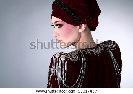 Portrait of Attractive model in exclusive design clothes on manners old-slavic. - stock photo