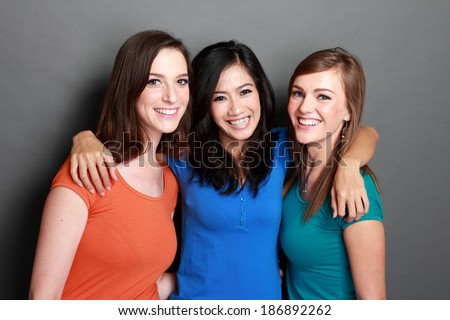 portrait of attractive multi racial three girls best friend together having fun - stock photo