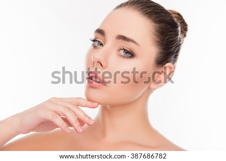 Portrait of attractive sensual young woman touching her chin - stock photo
