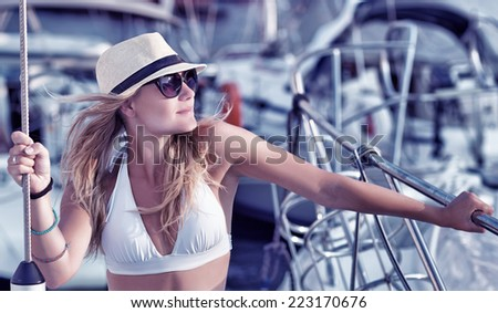 Portrait of attractive sexy woman tanning on the yacht, enjoying summer vacation in luxury sea cruise, freedom and enjoyment concept - stock photo