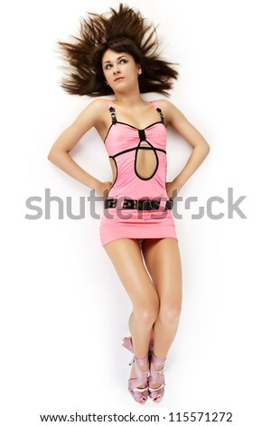 Portrait of attractive sexy women in pink dress lie on the floor. - stock photo