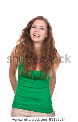 portrait of attractive smile teenage girl laughing, wear green shirt, with white teeth, brown long hair, isolated over white background concept of happy student, young pretty woman - stock photo