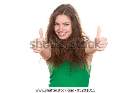 portrait of attractive smile teenage girl show thumbs up gesture, in green shirt, with white teeth, brown long hair, isolated over white background concept of success happy student, young pretty woman - stock photo