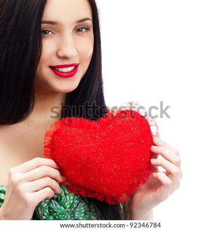 Portrait of attractive smiling woman with heart on white background