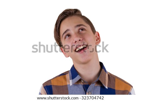 Portrait of attractive teen boy smiling and looking up being photographed in a studio. Isolated on white background - stock photo