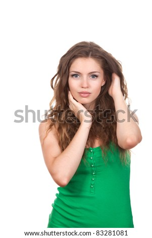 portrait of attractive teenage girl, with brown long curly hair, isolated over white background concept of beautiful young pretty woman, wear green shirt - stock photo