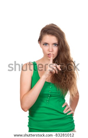 portrait of attractive teenage girl with finger on lips, brown long hair, isolated over white background concept of student show quiet, silence, secret gesture, young pretty woman - stock photo