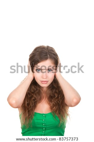 portrait of attractive teenage girl with hands on ears, isolated over white background - stock photo