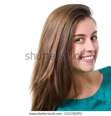 portrait of attractive teenager girl with perfect long brown hair smiling in cheerful mood, over white - stock photo
