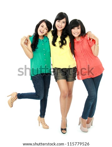 Portrait of attractive three teenage girls hugging each other isolated on white background - stock photo