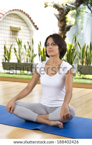 Portrait of Attractive Woman Exercising In A Fitness Center - stock photo