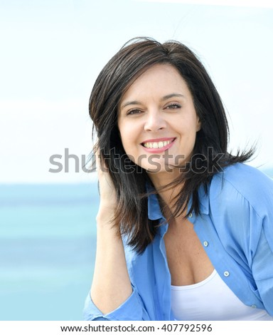 Portrait of attractive woman in blue shirt