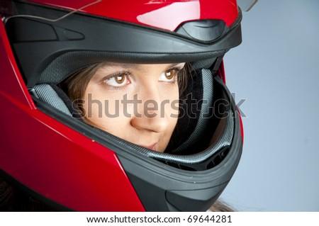 Portrait of attractive woman in motorbike helmet looking aside - stock photo