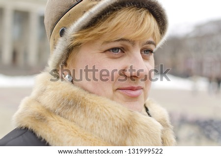 portrait of attractive woman in winter cloth outdoor