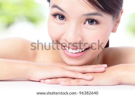portrait of attractive woman smile with green background , model is a asian beauty - stock photo
