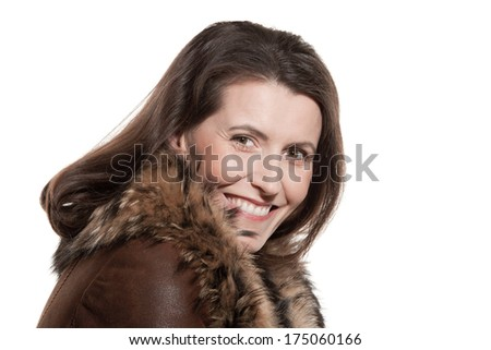 Portrait of attractive woman wearing sheepskin smiling isolated on white background - stock photo