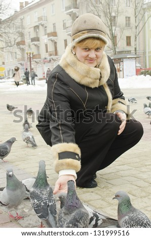 portrait of attractive woman with pigeons