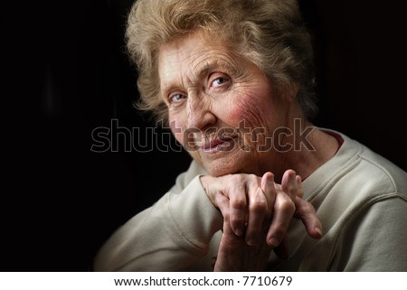 Portrait of attractive, wrinkled great-grandmother - stock photo