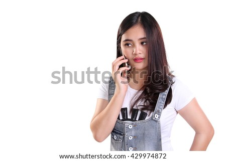 Portrait of attractive young Asian woman having a conversation using cellphone, isolated on white background with copyspace - stock photo