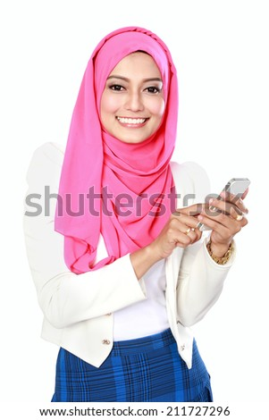 portrait of attractive young asian woman using mobile phone