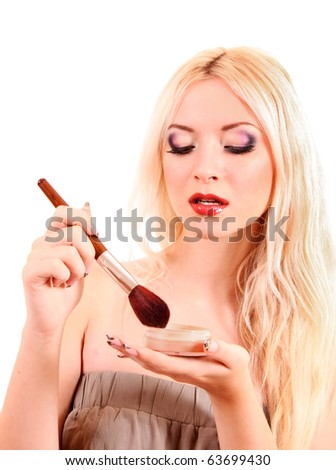 Portrait of attractive young blonde woman applying blusher