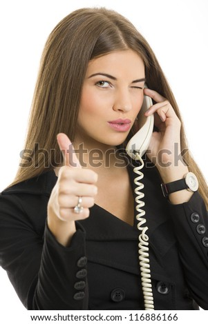 Portrait of attractive young business woman gesturing okay sign while talking on phone over white background. - stock photo