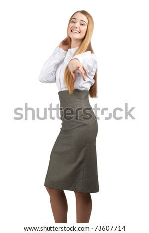 Portrait of attractive young businesswoman pointing at viewer and smiling, isolated on white - stock photo