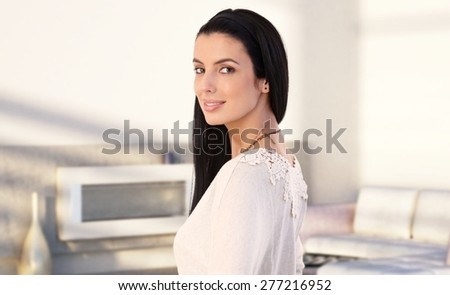 Portrait of attractive young caucasian woman at home, smiling. - stock photo