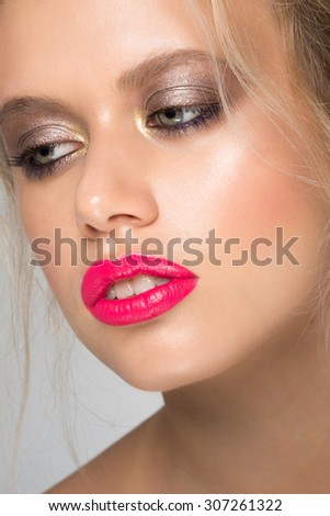 Portrait of attractive young caucasian woman with stylish makeup