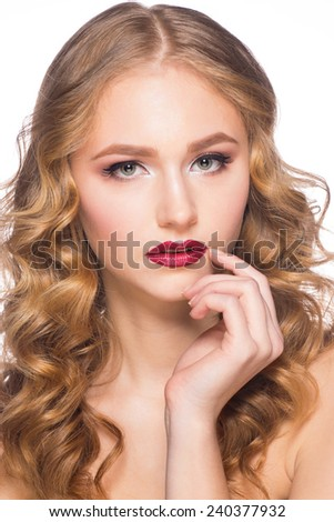 Portrait of attractive young caucasian woman with stylish makeup and wavy hairstyle