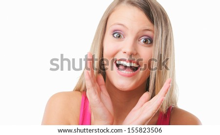 Portrait of attractive young female looking excited on white background - stock photo