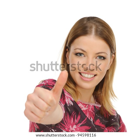 Portrait of attractive young female showing a thumbs up - stock photo