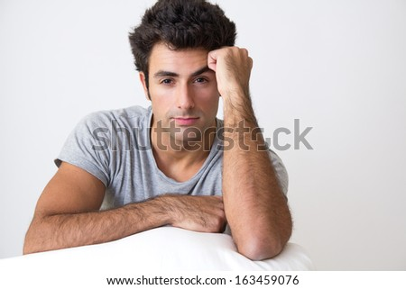Portrait of attractive young man happy to relax at home