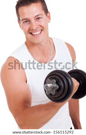 portrait of attractive young man working out with dumbbells - stock photo