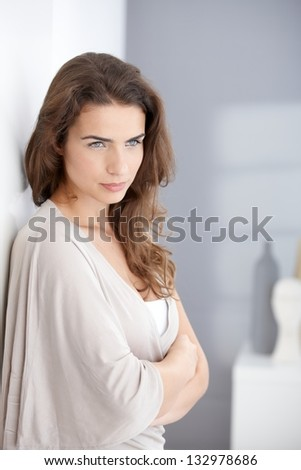 Portrait of attractive young thinking woman, looking away. - stock photo