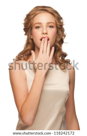 Portrait of  attractive young woman covering her mouth and looking surprised. Isolated on white background - stock photo