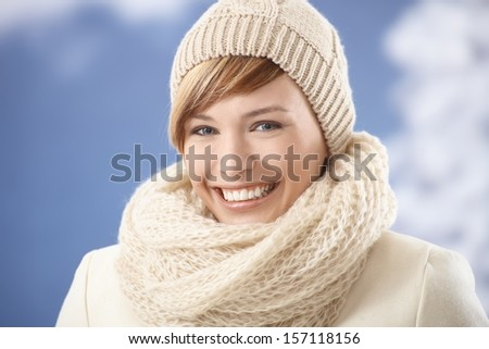 Portrait of attractive young woman in winter clothes, smiling - stock photo