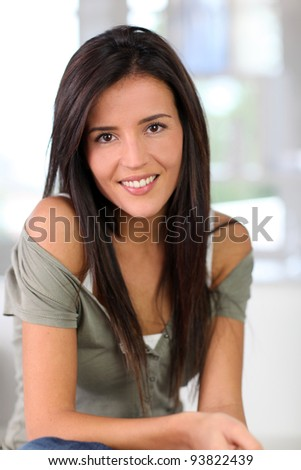 Portrait of attractive young woman relaxing at home - stock photo