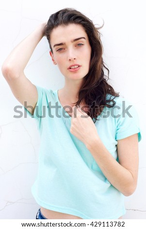 Portrait of attractive young woman with hand in hair - stock photo